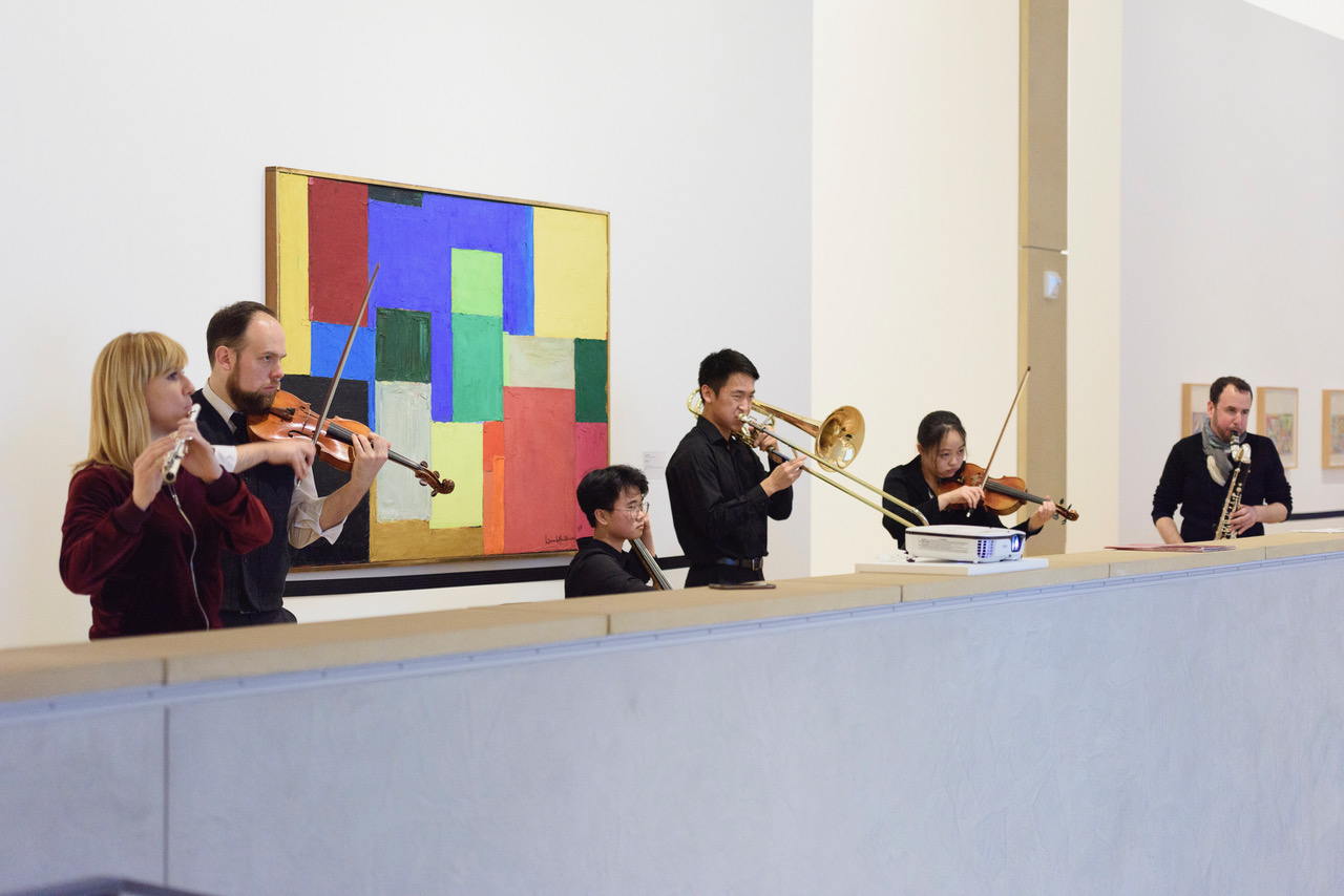 Members of the Stanford New Ensemble and the International Contemporary Ensemble play from Mark Applebaum's compostion, Metaphysics of Notation, in the Anderson Collection gallery.