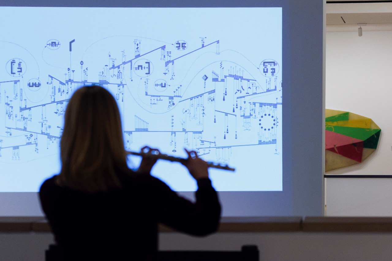 Flautist Alice Teyssier of the International Contemporary Ensemble plays from Mark Applebaum's compostion, Metaphysics of Notation, in the Anderson Collection gallery.