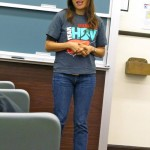 Fiona Ma gives her talk, wearing Stanford Team HBV shirt!