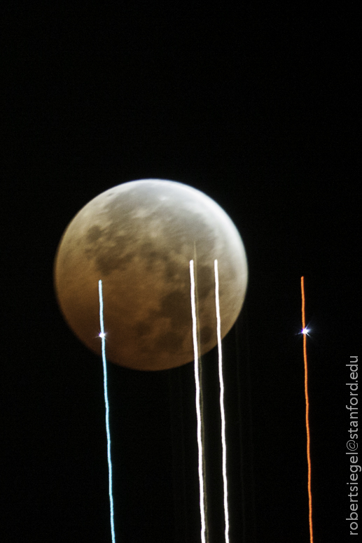 jet in front of lunar eclipse