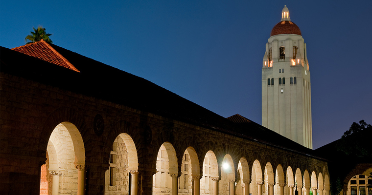 a beautiful night shot of the Stanford Quad featuring Hoover Tower