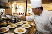 Chef serving at arrillaga family dining commons