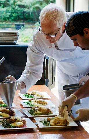Stanford Catering's Executive Chef Andrew Main prepares for an event.