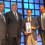 Sam receiving SNM's 2006 Paul C. Aebersold Award for outstanding achievement in basic nuclear medicine science during the society's 53rd Annual Meeting in San Diego. Pictured with Peter Conti, Fred Fahey, and Mathew Thakur.